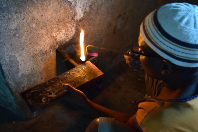 Salamao the silversmith at work.
